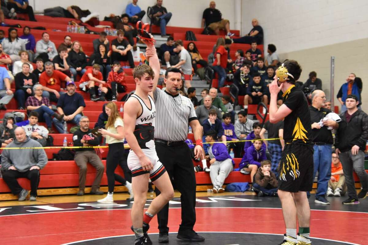 Fairfield Warde's Nate Cuoco (in white) is among the Mustang wrestlers who will miss out on their senior season.