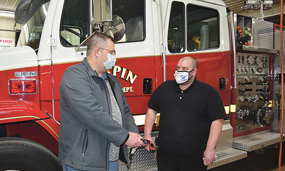 Chapin Volunteer Fire Department Chief Scott Pahlmann and volunteer firefighter Mark Lovekamp discuss how to properly use a thermal-imaging camera. Fundrasiers help volunteer fire departments buy needed equipment. Photo: Rochelle Eiselt   Journal-Courier