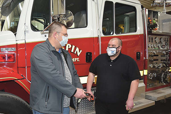 Chapin Volunteer Fire Department Chief Scott Pahlmann and volunteer firefighter Mark Lovekamp discuss how to properly use a thermal-imaging camera. Fundrasiers help volunteer fire departments buy needed equipment.