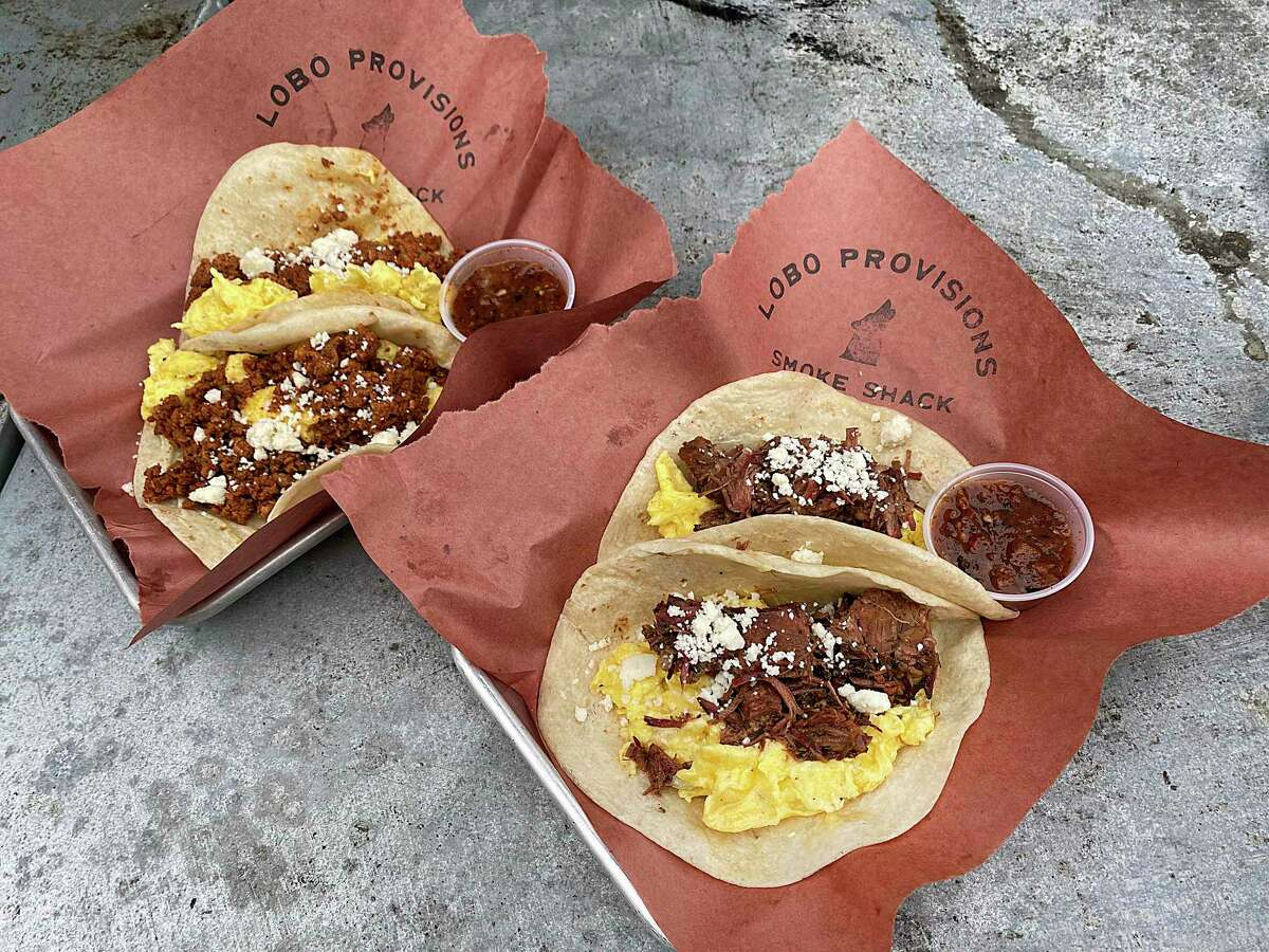 Breakfast tacos with chorizo, left, and brisket are part of the weekend menu at Lobo Provisions Smoke Shack.
