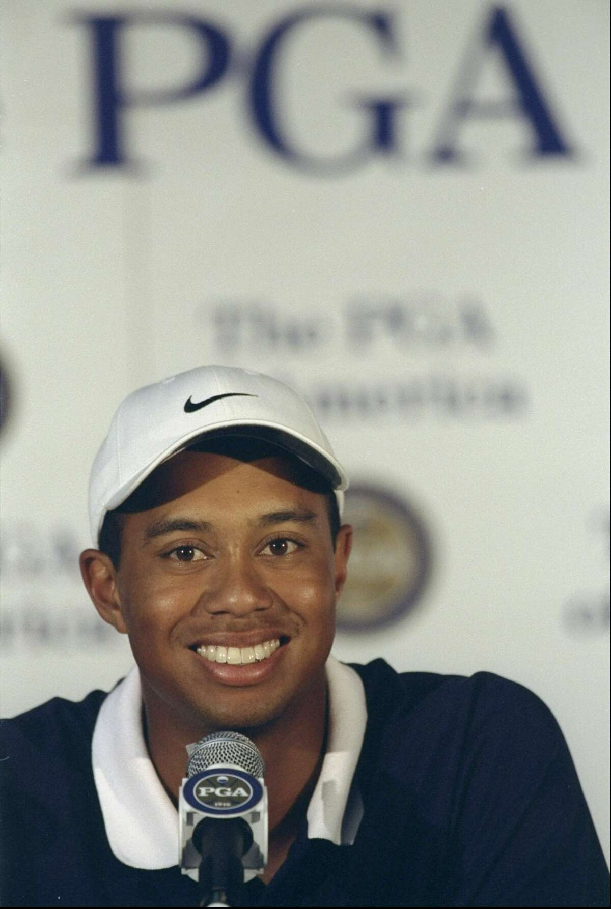 Tiger Woods talks to the press in 1998.
