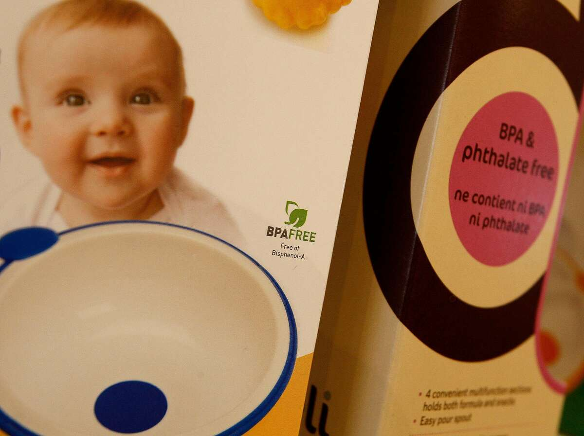 Items at a natural products store for children are marked as free of bisphenol A. California will broaden its warning labels.