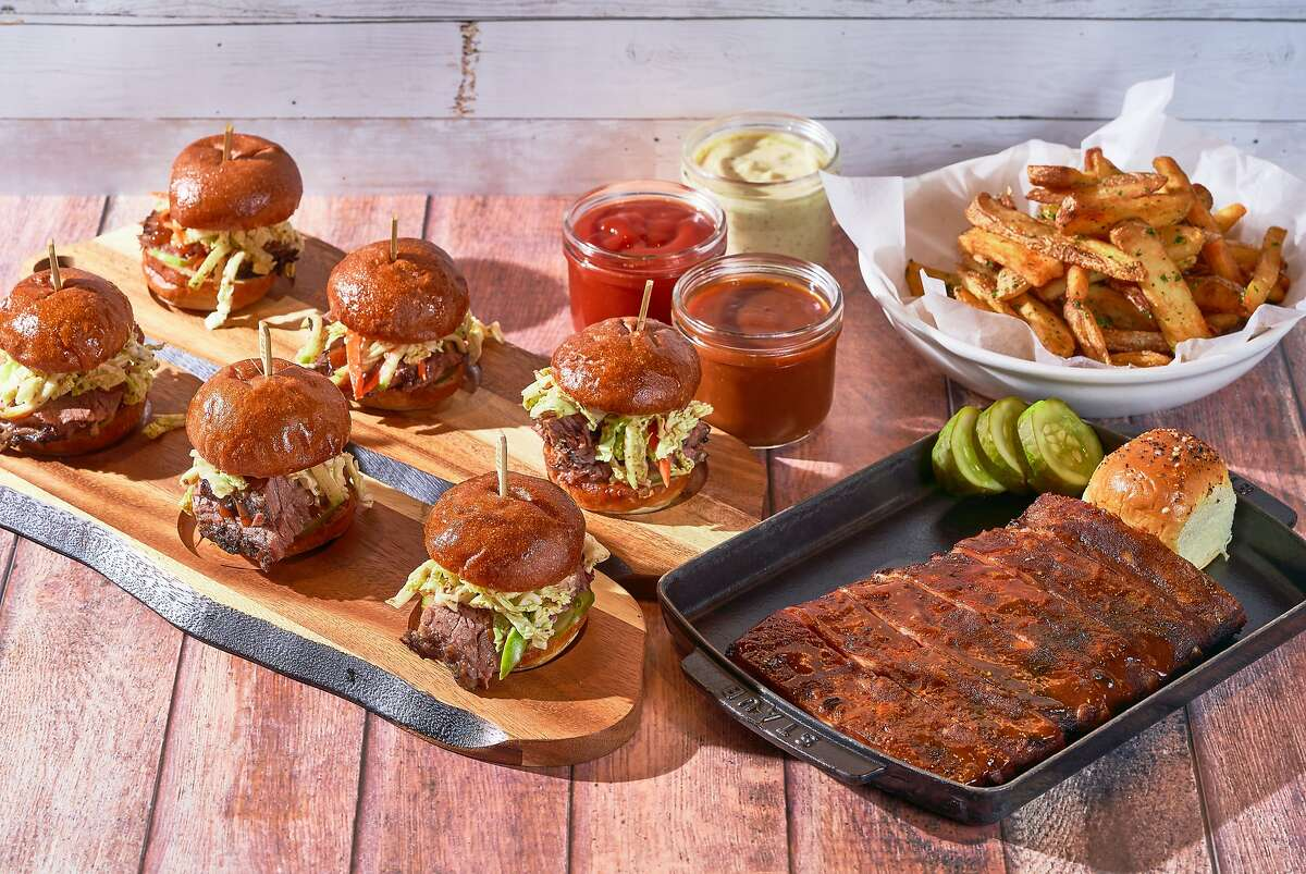 The Big Game Spread from International Smoke includes six brisket sliders and duck fat fries. Ribs can be added as an extra.
