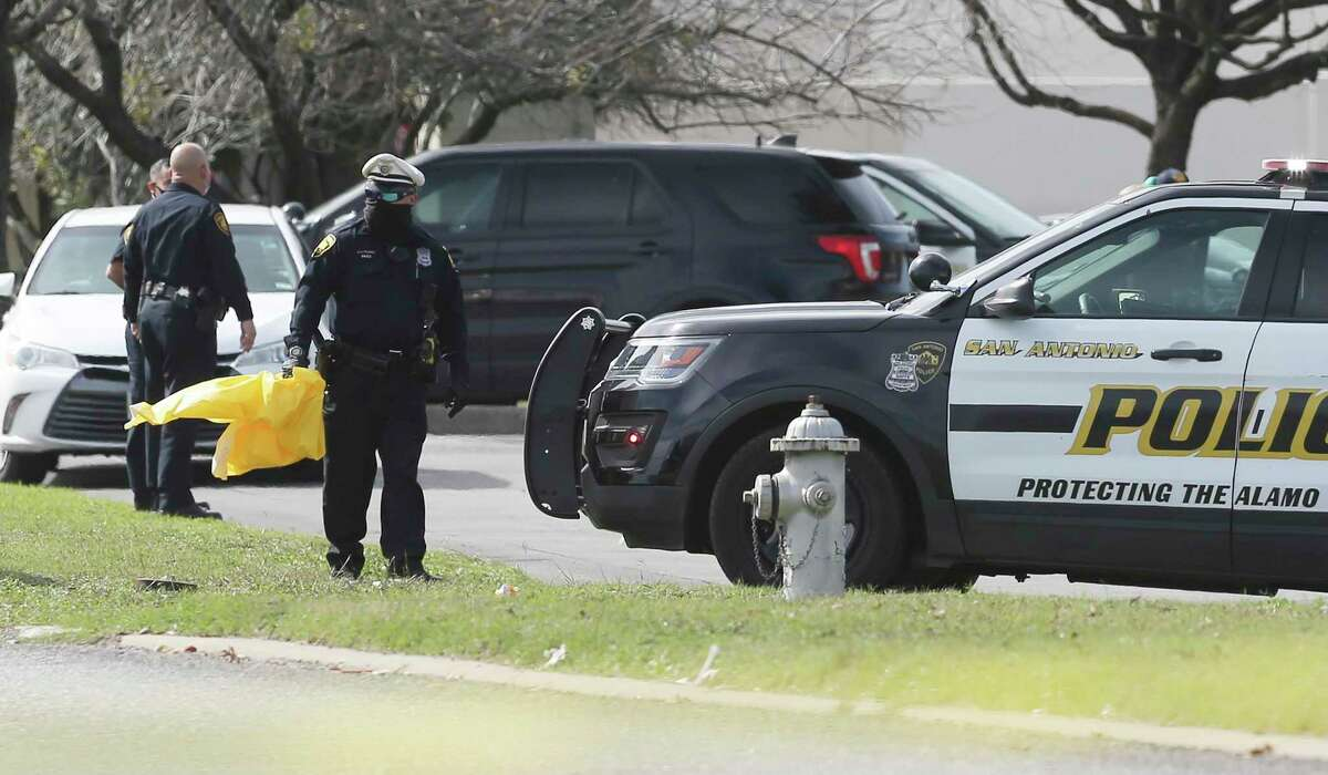San Antonio police officers investigate a fatal shooting in a parking lot at South Park Mall on Wednesday, Jan. 27, 2021. Four officers shot a man who had entered the mall, apparently with a gun. He was told to leave. As officers tried to surround him, they shot and killed him.