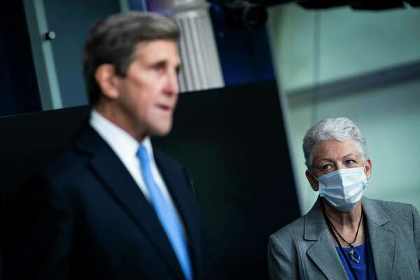 Climate envoy John Kerry and climate coordinator Gina McCarthy speak at a White House briefing. Kerry said the climate crisis has given President Biden little choice but to act on shifting the United States toward renewable energy.