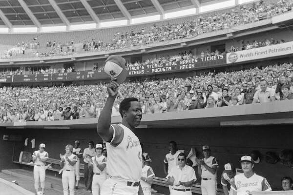 Atlanta Braves' Hank Aaron acknowledges the crowd after belting his 700th career home run during a July 21, 1973 game against the Philadelphia Phillies.