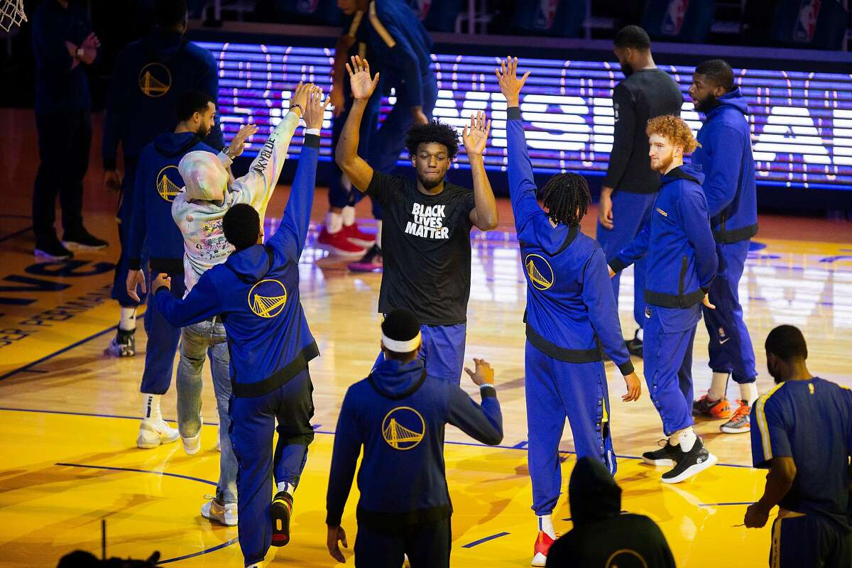 Golden State Warriors center James Wiseman is introduced before an NBA game against the Los Angeles Lakers at Chase Center, Friday, Jan. 8, 2021, in San Francisco, Calif.