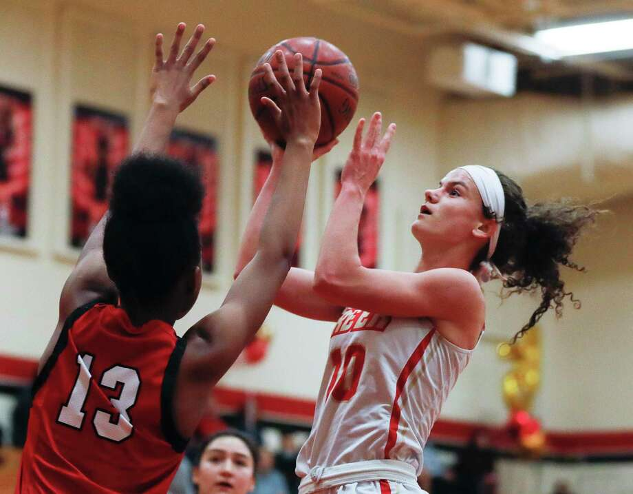 Caney Creek's Hannah Foster (10) draws a foul from Cleveland's Ki'mora Taylor (13) during the first quarter of a District 20-5A high school basketball game at Caney Creek High School, Wednesday, Jan. 27, 2021, in Grangerland. Photo: Jason Fochtman, Houston Chronicle / Staff Photographer / 2021 © Houston Chronicle