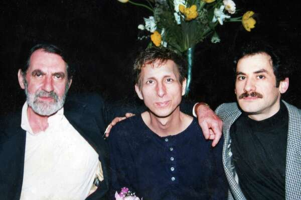 """A 1993 photo of Dr. Joseph Sonnabend, left, with patients Michael Callen, center, and Richard Berkowitz, who became AIDS activists and co-wrote the manual """"How to Have Sex in an Epidemic: One Approach."""""""