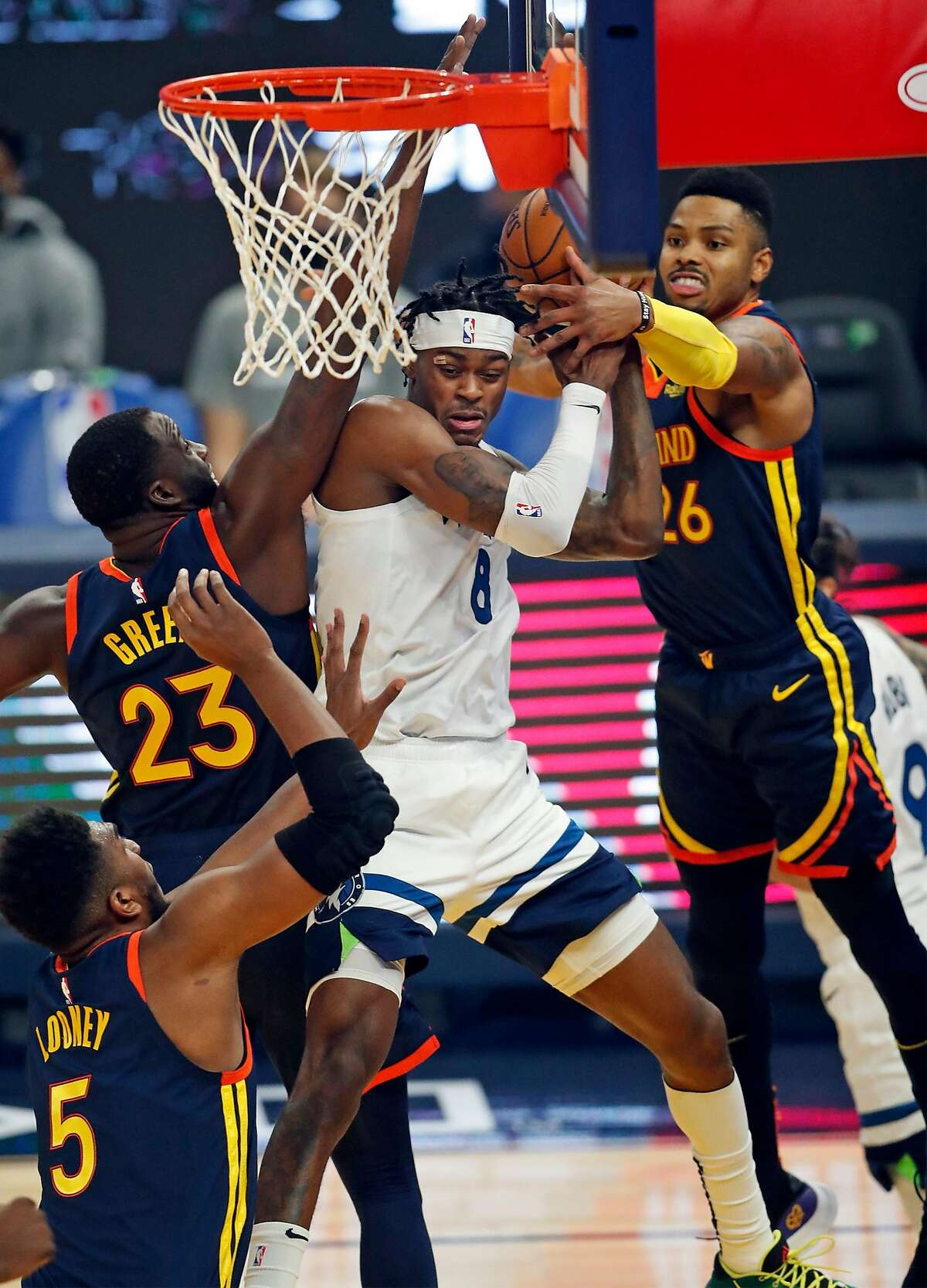 Golden State Warriors' Kent Bazemore and Draymond Green defend against Minnesota Timberwolves' Jarred Vanderbilt in 1st quarter during NBA game at Chase Center in San Francisco, Calif., on Wednesday, January 27, 2021.