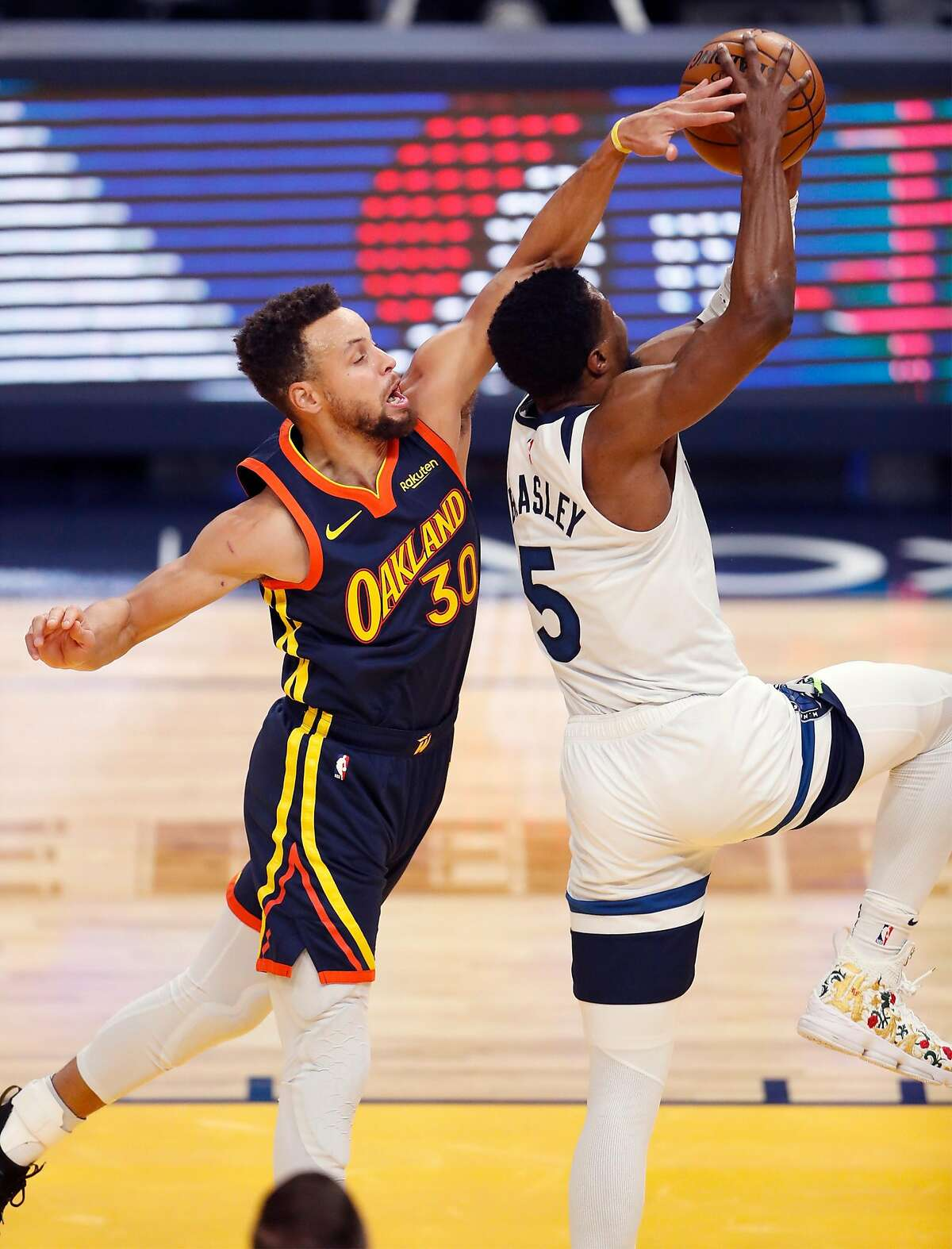 Golden State Warriors' Stephen Curry defends against Minnesota Timberwolves' Malik Beasley in 1st quarter during NBA game at Chase Center in San Francisco, Calif., on Wednesday, January 27, 2021.