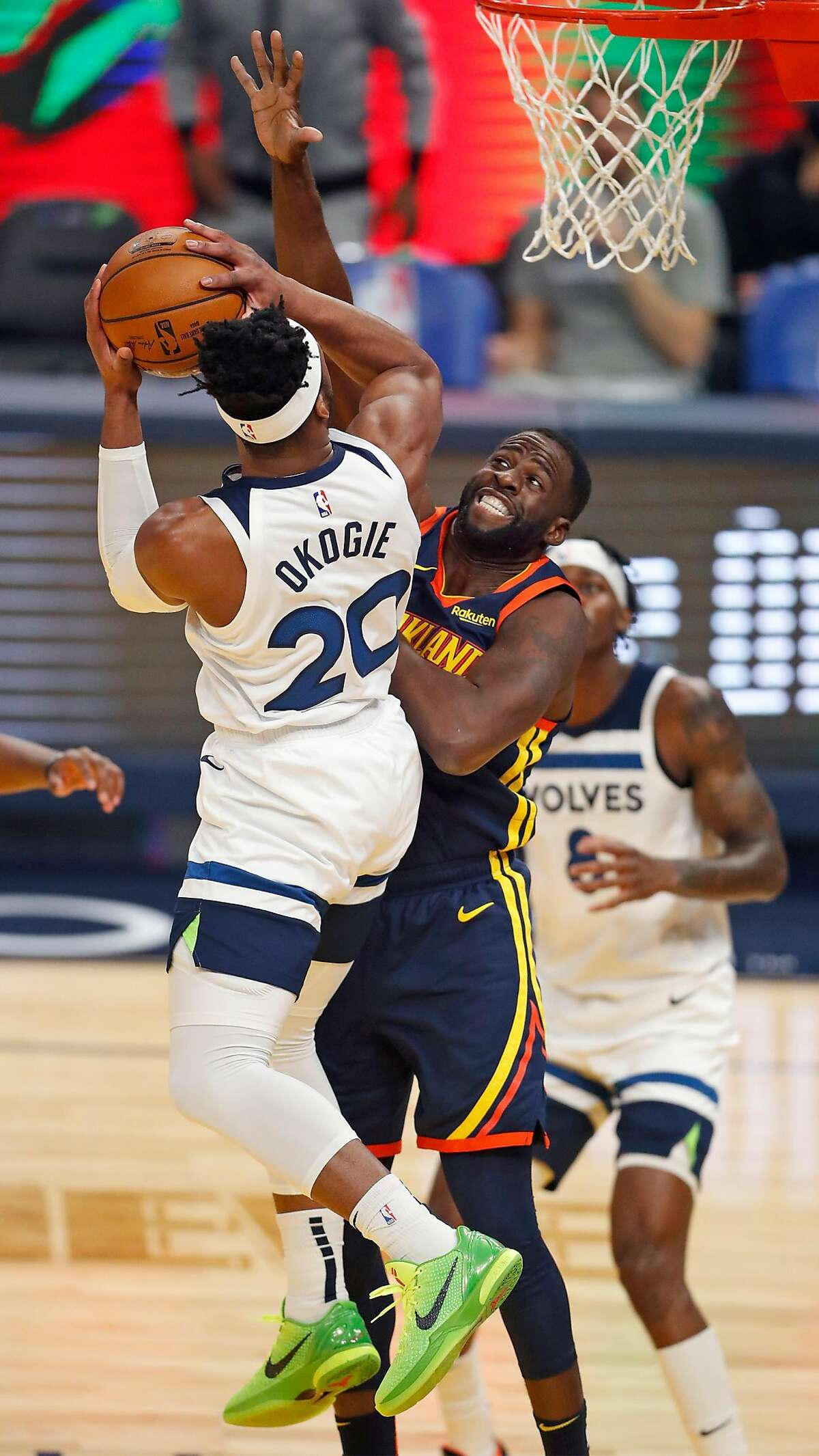 Golden State Warriors' Draymond Green defends against Minnesota Timberwolves' Josh Okogie in 1st quarter during NBA game at Chase Center in San Francisco, Calif., on Wednesday, January 27, 2021.