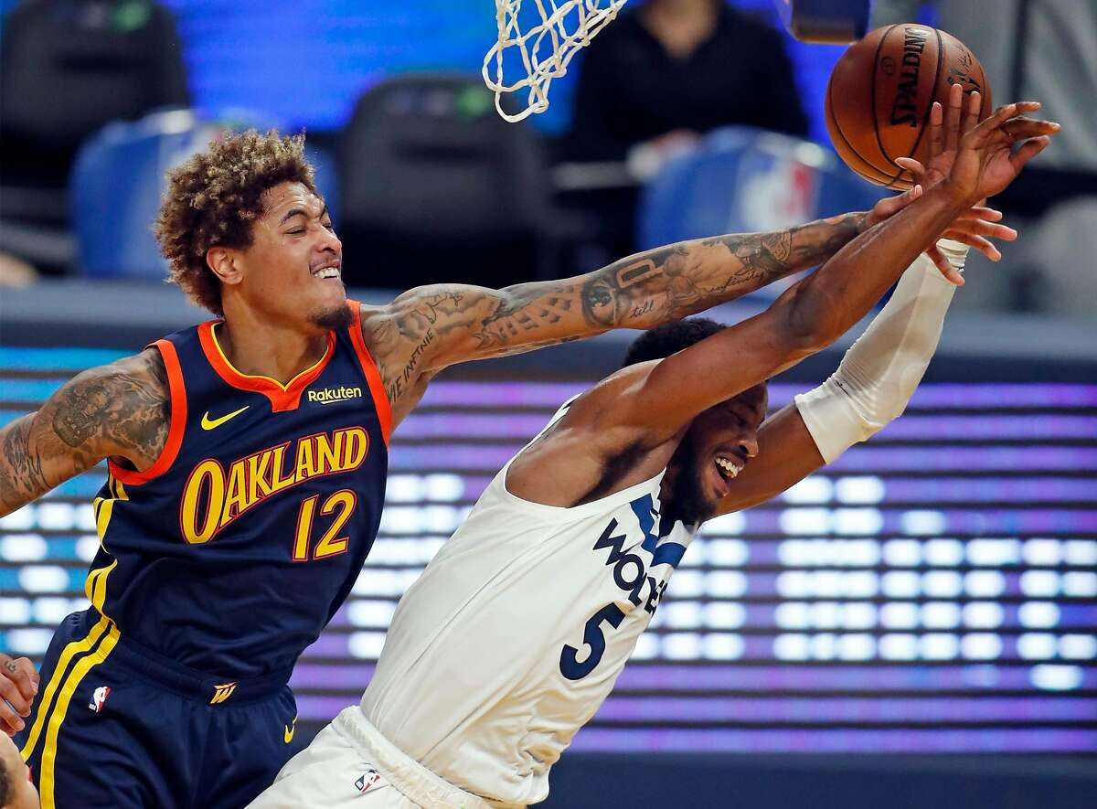 Golden State Warriors' Kelly Oubre, Jr. blocks a shot attempt by Minnesota Timberwolves' Malik Beasley in 2nd quarter during NBA game at Chase Center in San Francisco, Calif., on Wednesday, January 27, 2021.