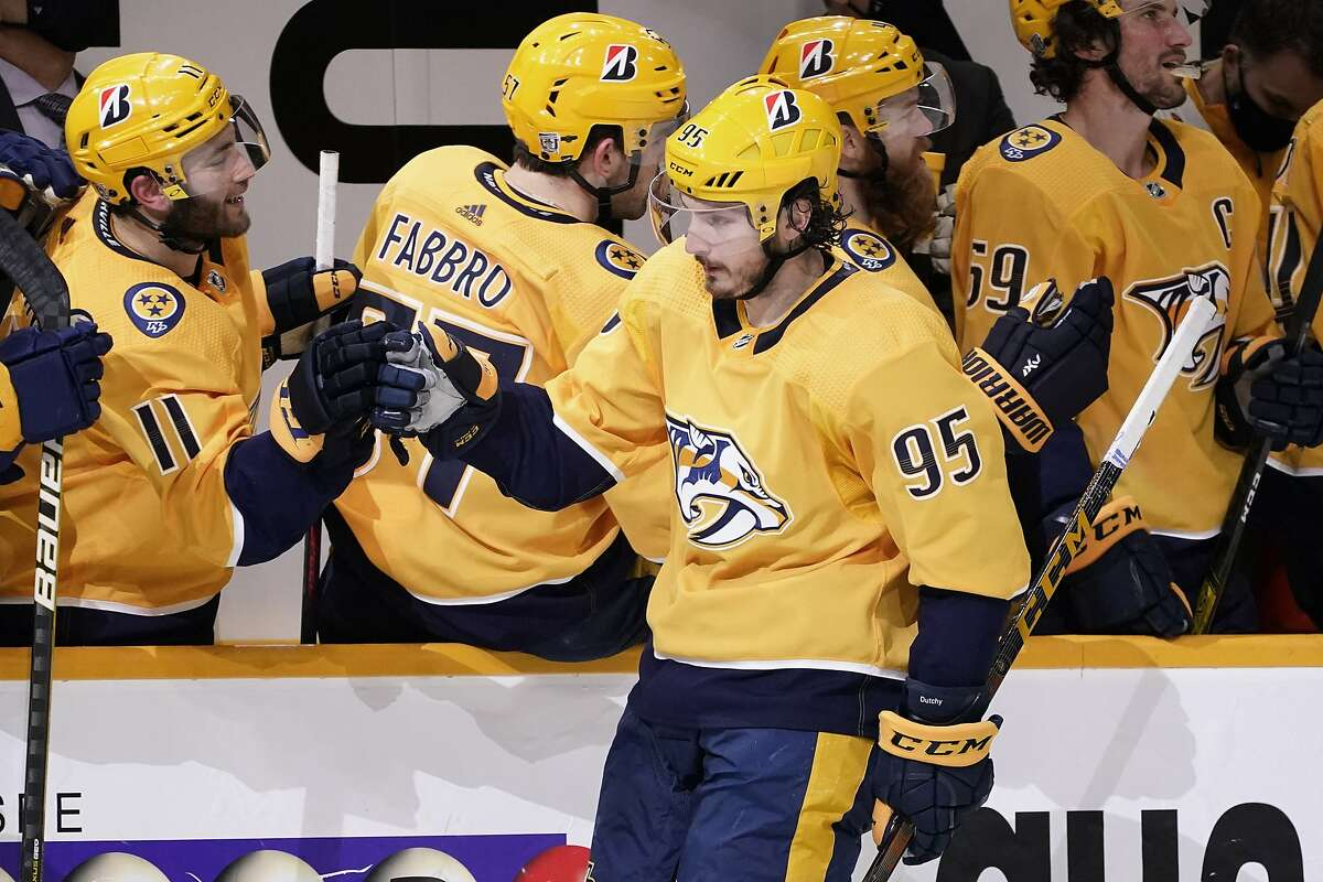 Nashville teammates congratulate center Matt Duchene (95) after his backhand goal lifted them to a win over Chicago in a shootout, the second straight night the teams needed extra time.