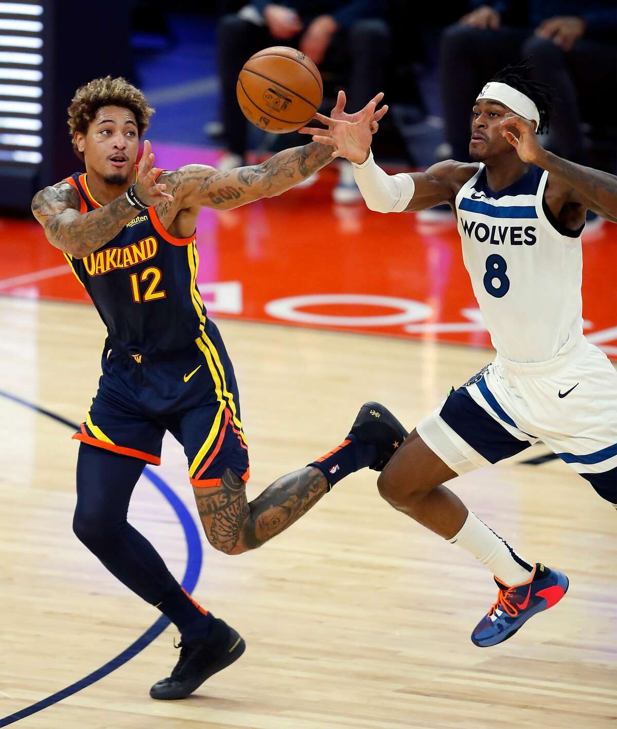 Minnesota Timberwolves' Jarred Vanderbilt deflects a pass intended for Golden State Warriors' Kelly Oubre, Jr. in 2nd quarter during NBA game at Chase Center in San Francisco, Calif., on Wednesday, January 27, 2021.