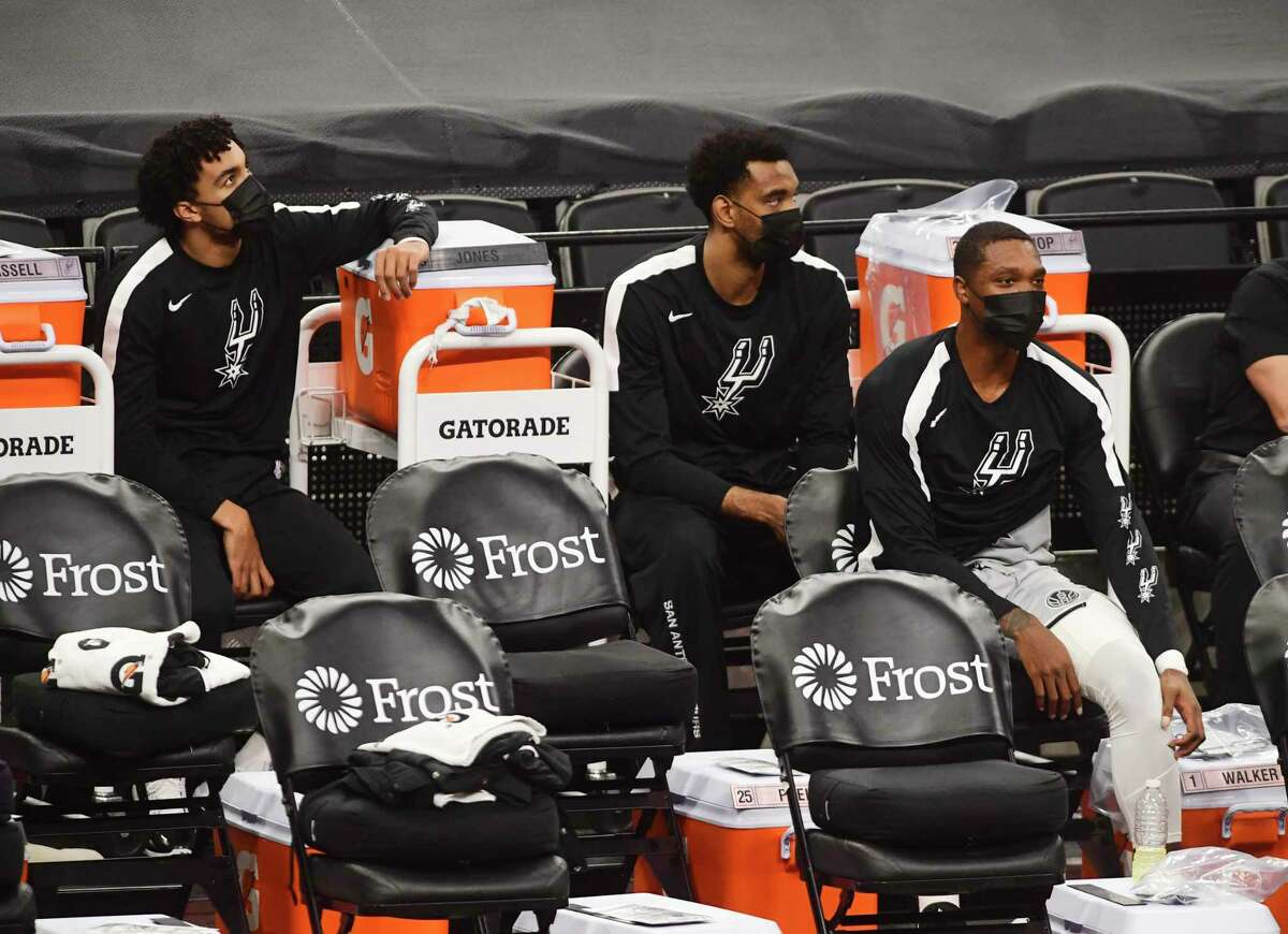 The San Antonio Spurs bench sits socially distanced during NBA action against the Boston Celtics n the AT&T Center on Wednesday, Jan. 27, 2021.