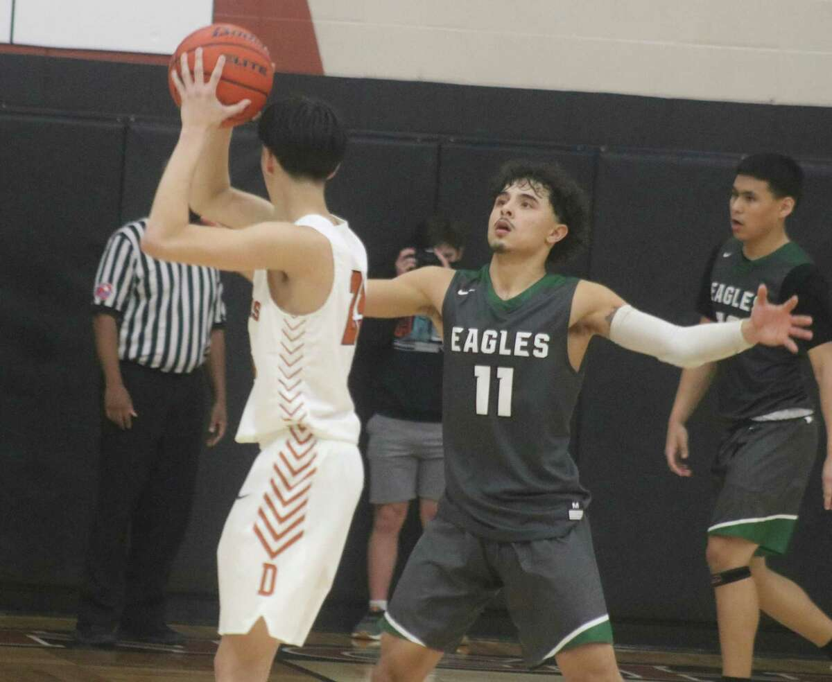 Pasadena's Benito Tello guards Dobie's Damian Garcia during fourth-period action Wednesday night. Garcia was the game's leading scorer with 17 points, reserving 14 for the second half.