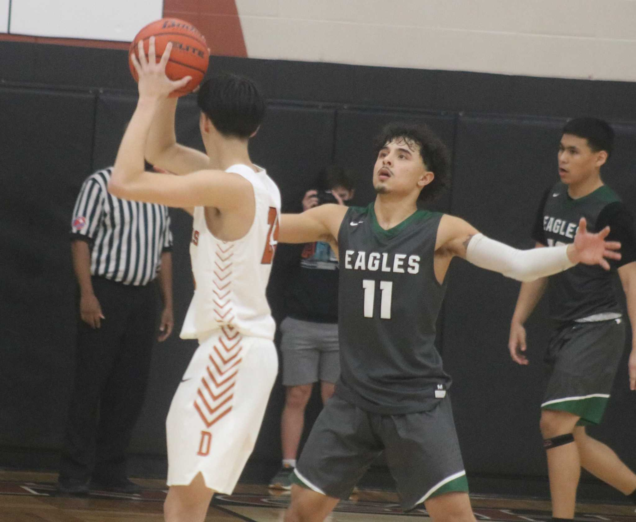 Longhorns capture fifth straight district win after outscoring the Eagles 20-6 in the fourth