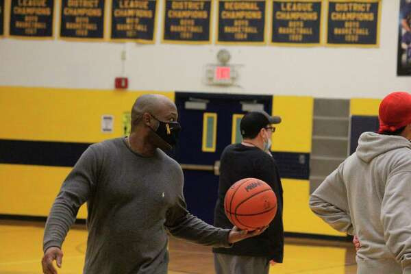Baldwin assistant coach Shawn WIlliams (left) keeps an eye on the action during Tuesday's basketball practice. (Star photo/John Raffel)