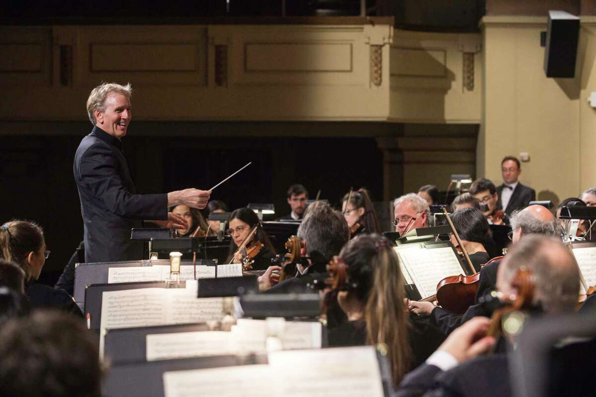 New Haven Symphony Orchestra music director and conductor Alasdair Neale leads the orchestra in a 2019 performance.