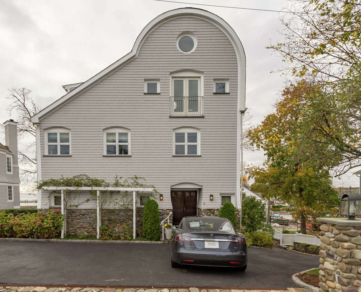 Unusually-shaped house on an unusually named street at 8 Nylked Terrace, Norwalk. This street in Norwalk's private Pine Point Association is dotted with 11 houses, among them 8 Nylked Terrace, a contemporary colonial house built in 1992 and