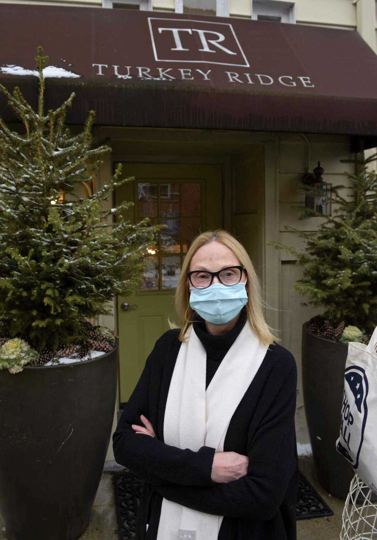 """Nadine Dolhy, owner of the Turkey Ridge gift shop, is closing her store after 22 years to enter """"semi-retirement"""". Ridgefield, Conn, Wednesday, January 27, 2021. """"It [the business] could pop up any time in all different manners or forms,"""" she said. Dolhy said she could even consider keeping the store if her landlord makes her an """"offer [she] can't refuse."""" The decision to close was """"pragmatic,"""" she said. She's """"well over"""" retirement age and knows she needs a break."""