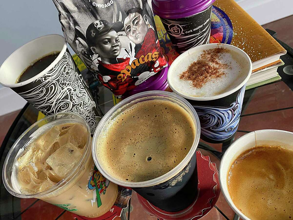 The menu at the new Tandem coffee shop on San Antonio's South Side includes, clockwise from left, an Estrella Latte (cinnamon and star anise), house blend drip coffee, coffee beans from Dark Matter in Chicago, a vanilla latte, a cortado and a Busted Sandal porter.