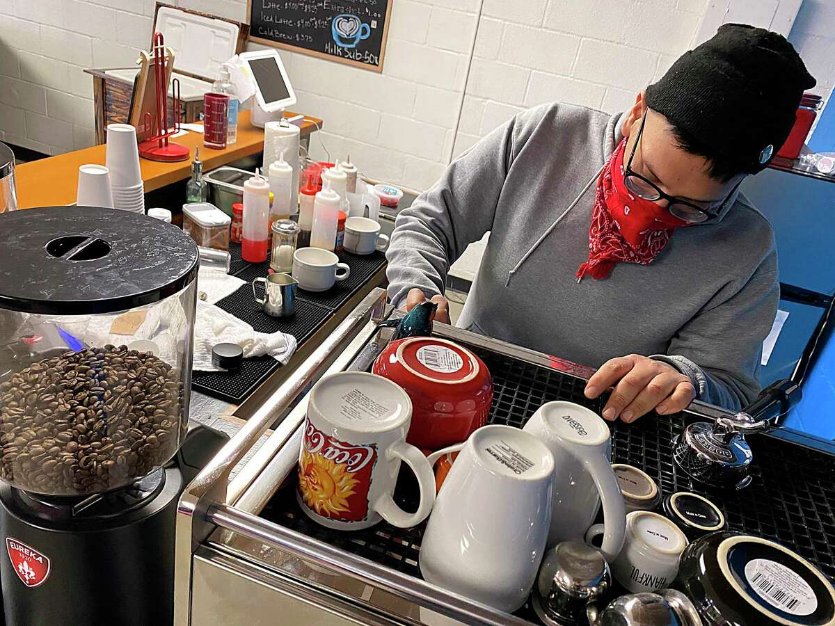 Anthony Benavides uses beans from What's Brewing Coffee Roasters for coffee drinks at his new Cultura coffee shop on San Antonio's South Side.