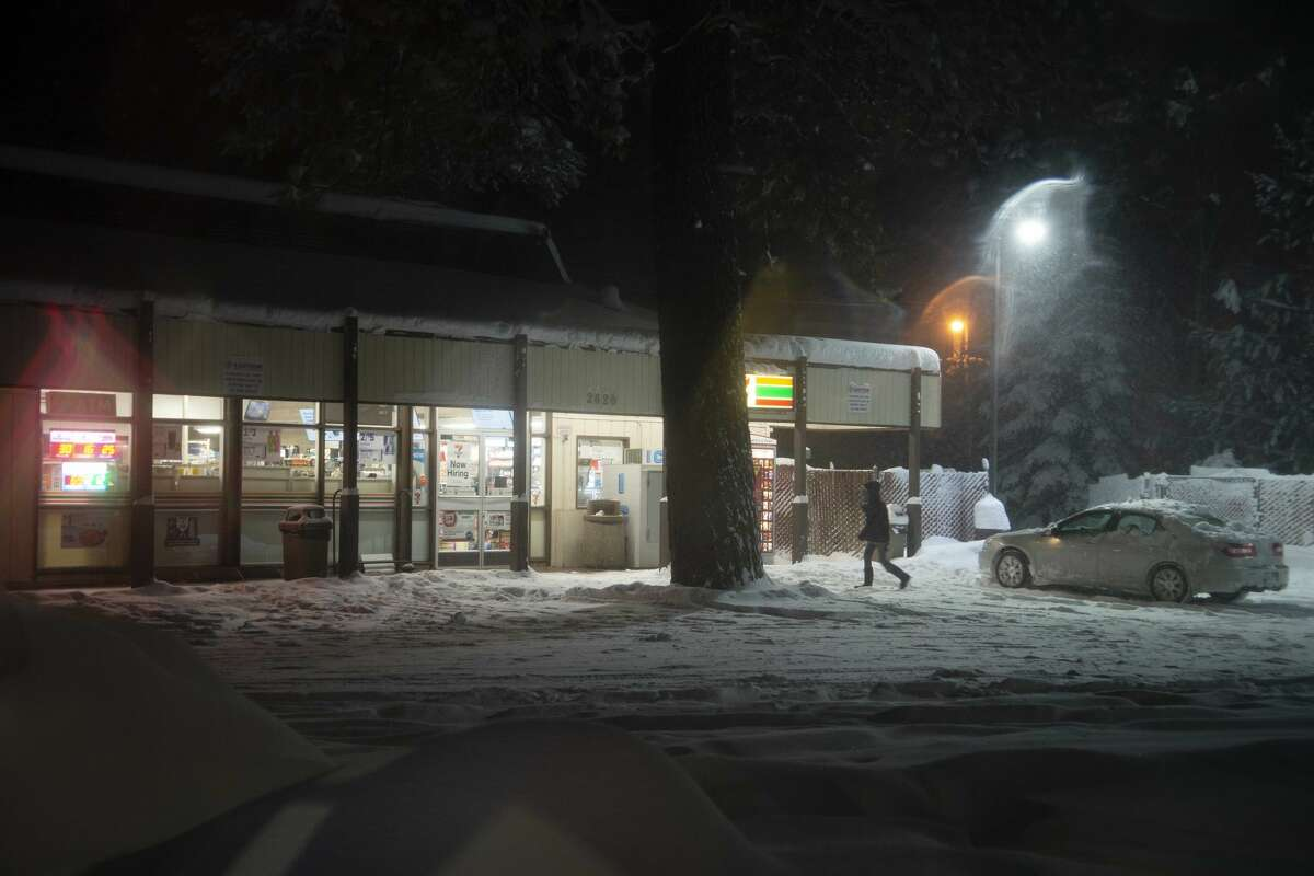 A customer heads into a convenience store during a heavy snowfall in South Lake Tahoe, Calif. on Jan 28, 2021. Residents of South Lake Tahoe brace for and begin to dig out of massive snowfall.