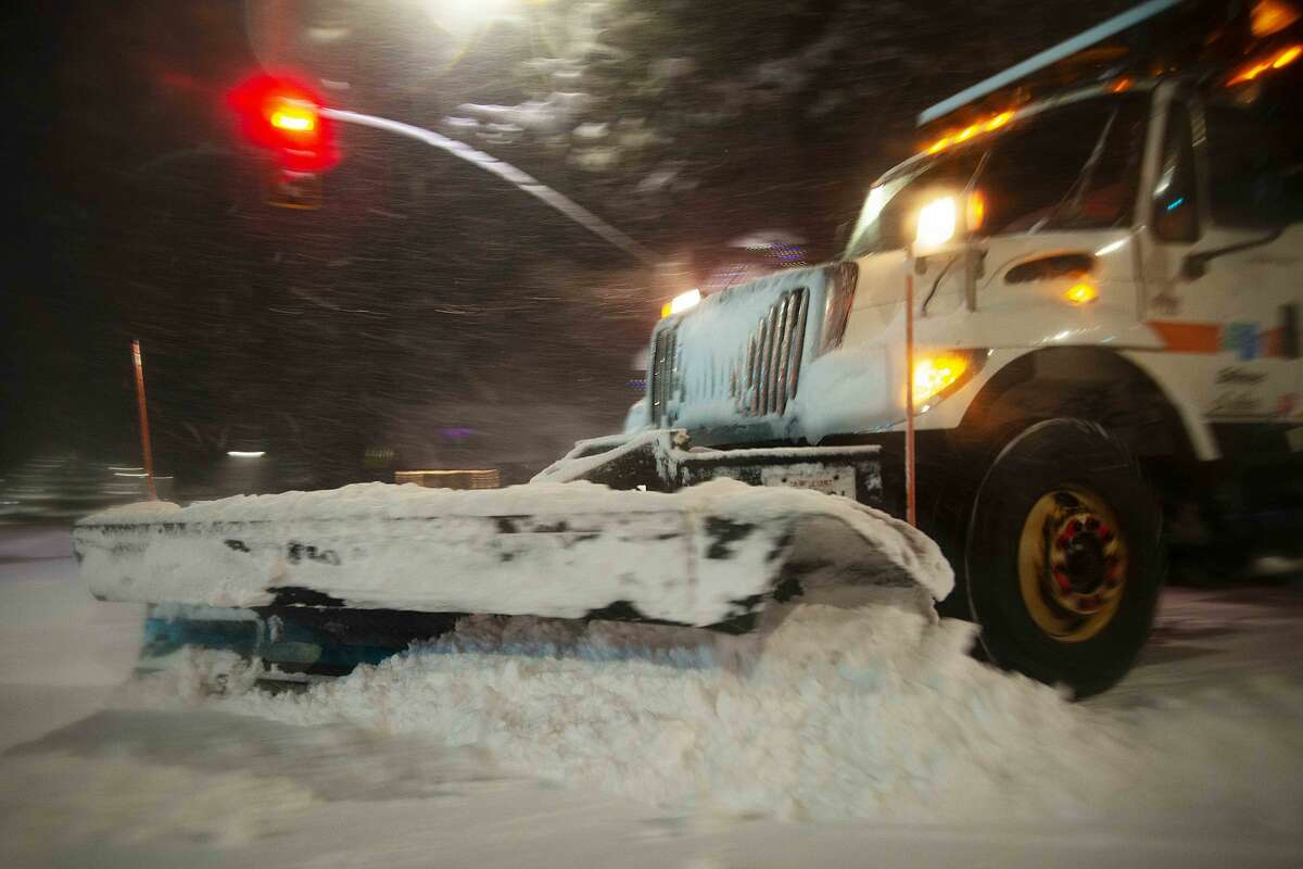 A CalTrans snow plow clears freshly fallen snow off the street in South Lake Tahoe, Calif. on Jan. 28, 2021. Residents of South Lake Tahoe brace for and begin to dig out of massive snowfall.