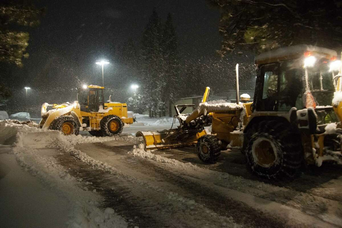 Snow plows work in tandem to remove snow from a road in South Lake Tahoe, Calif. on Jan 28, 2021. Residents of South Lake Tahoe brace for and begin to dig out of massive snowfall.