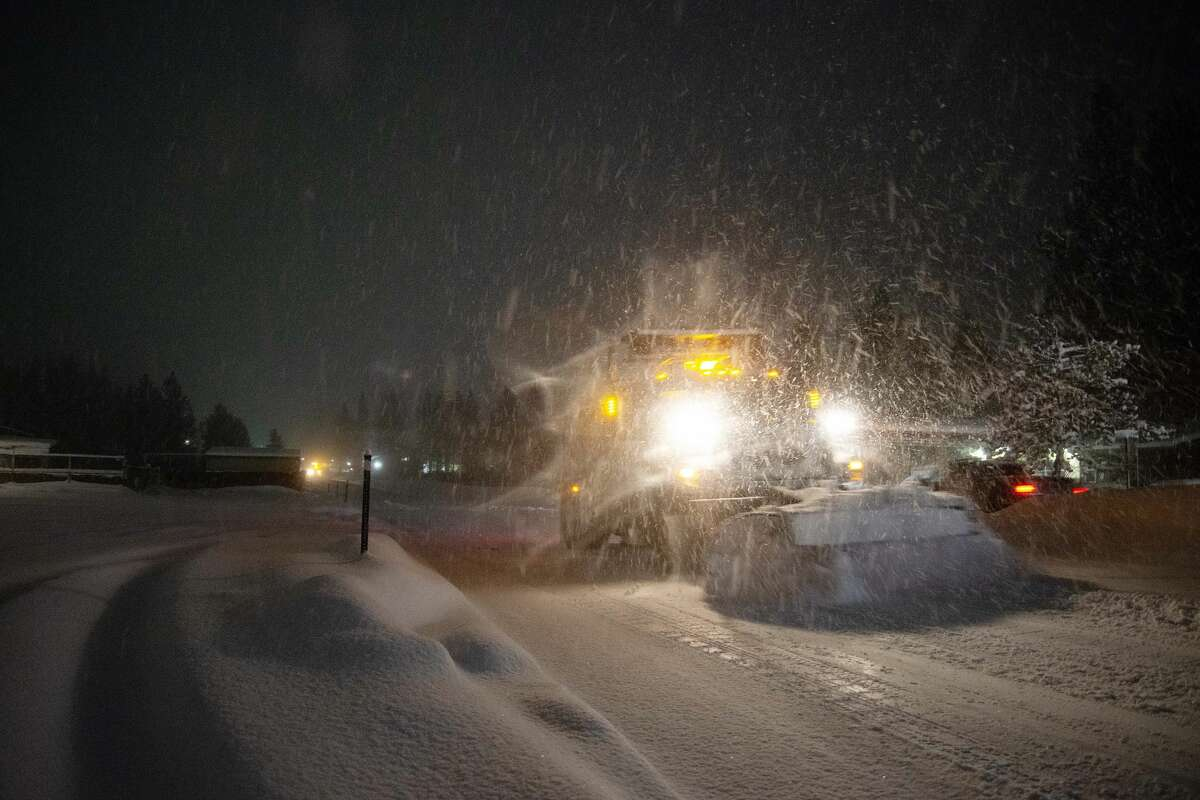 A snow plow clears freshly fallen snow off the street in South Lake Tahoe, Calif. on Jan. 28, 2021. Residents of South Lake Tahoe brace for and begin to dig out of massive snowfall.