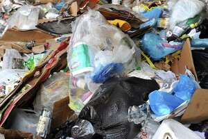Newspapers, cans, bottles and other recycled material sits in a huge pile at the Winters Bros. Waste Systems of Connecticut recycling facility on White Street in Danbury.