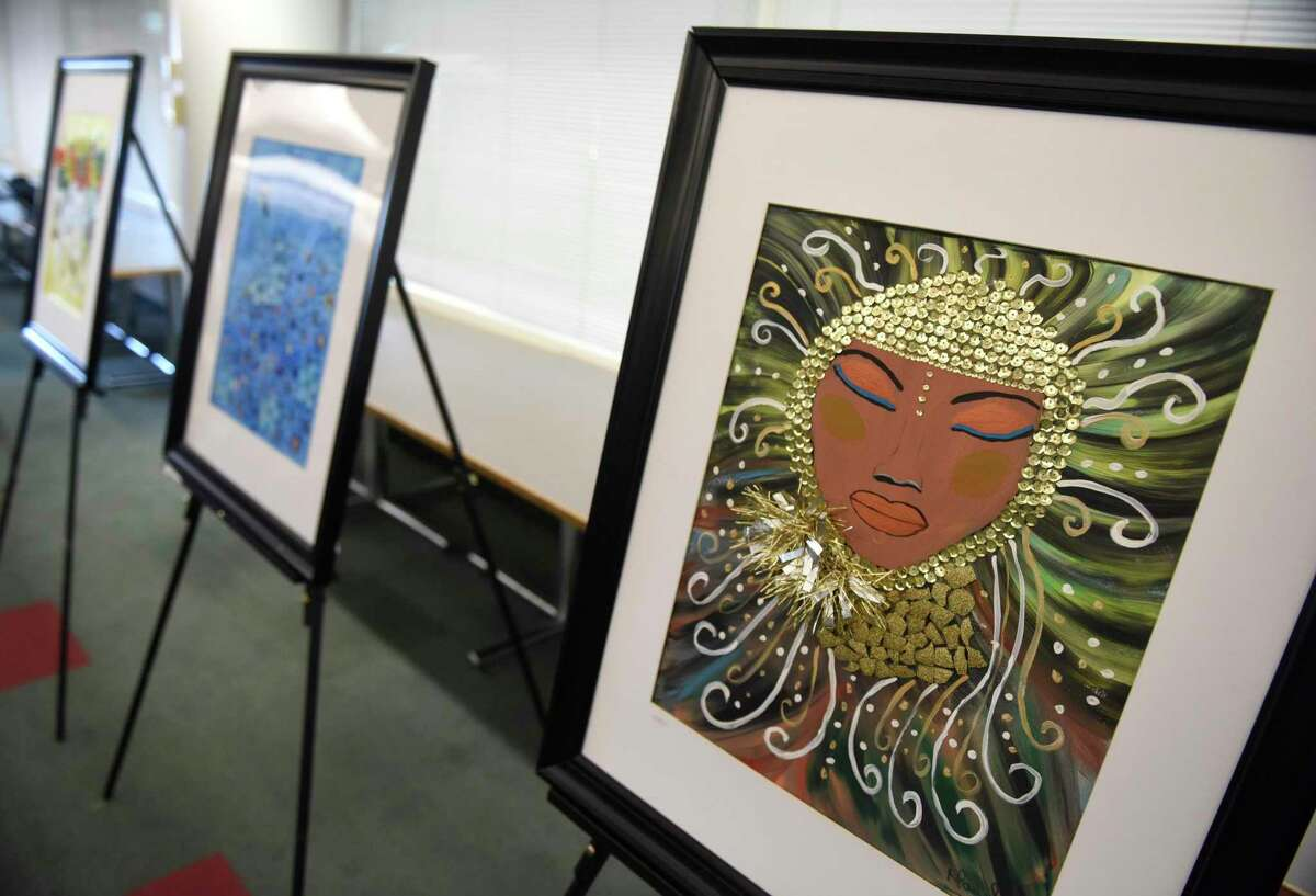 Author Mayole González' artwork is displayed during the book launch event at the Government Center in Stamford, Conn. Sunday, Jan. 12, 2020. The event was put on by the Parent Leadership Training Institute, People Empowering People, and the Ecuadorian Civic Committee of Fairfield County.