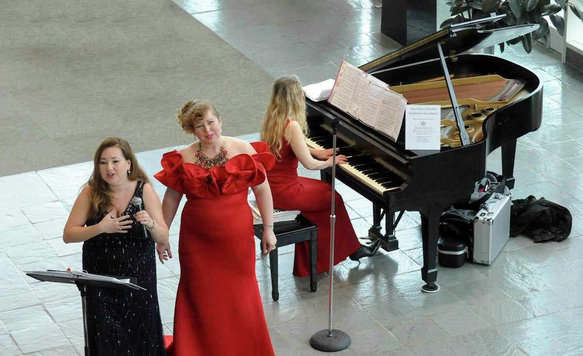 Liliya Bikbova and Yuliya Kirichenko sings a variety of classical opera songs, accompanied by pianist Alla Zouborev during a performance at the Stamford Government Center on June 18, 2019 in Stamford, Connecticut.