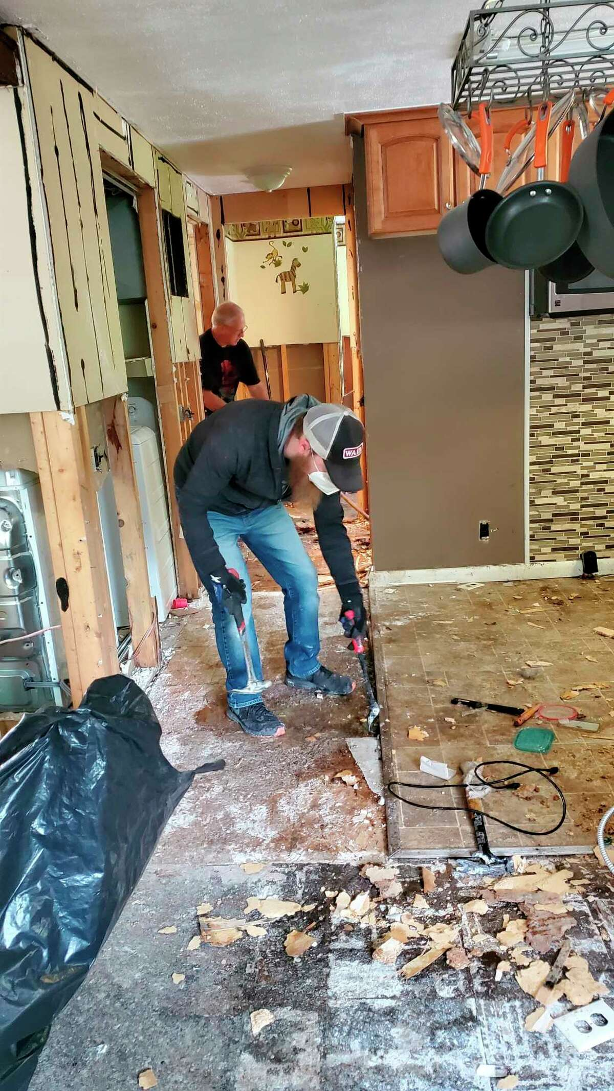 Nick Sklar and his team work with homes damaged by the floods. (Photo Provided)