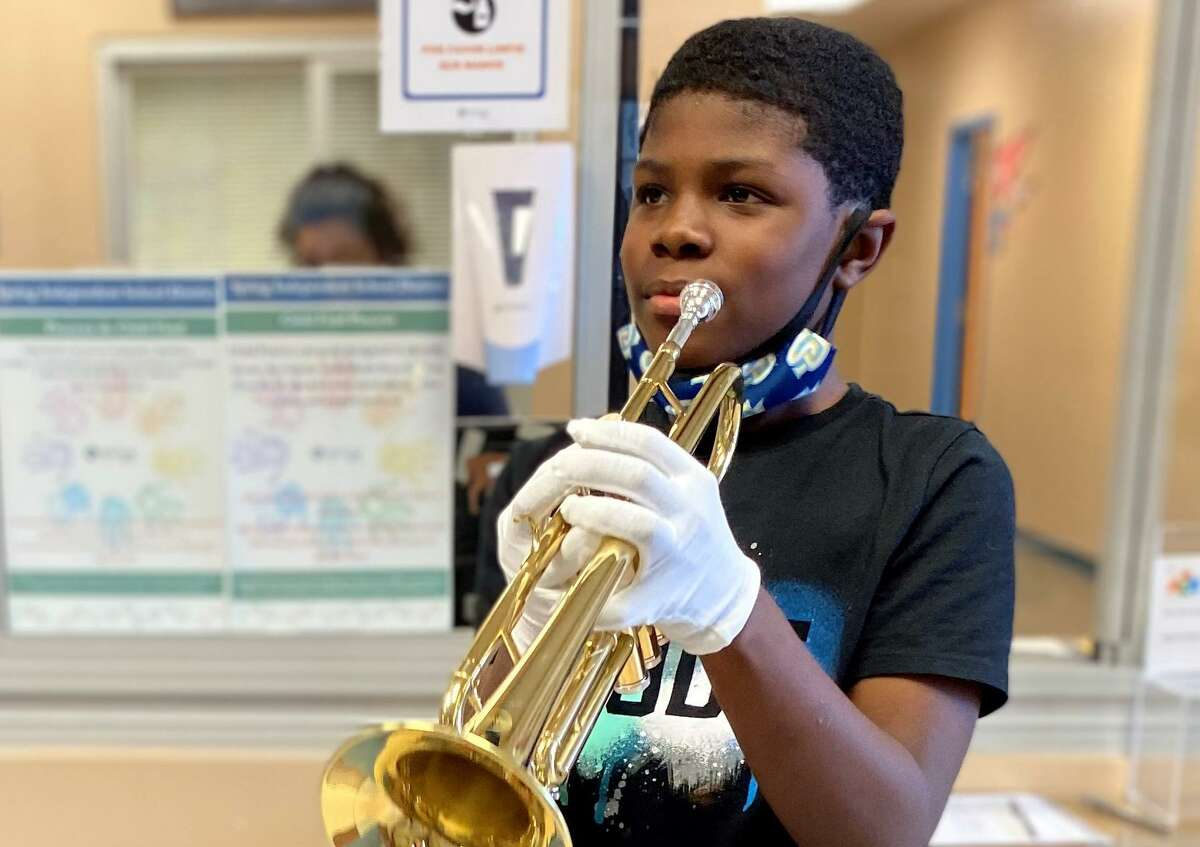Ponderosa Elementary student Jaron Collins with his new trumpet, given to him by an anonymous faculty member.