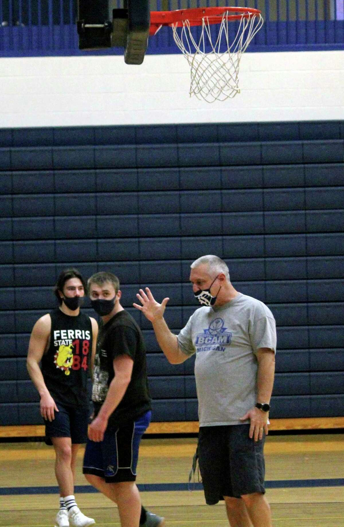 Morley Stanwood boys basketball coach Bob Raven instructs some of his players during a recent practice. (Pioneer photo/John Raffel)