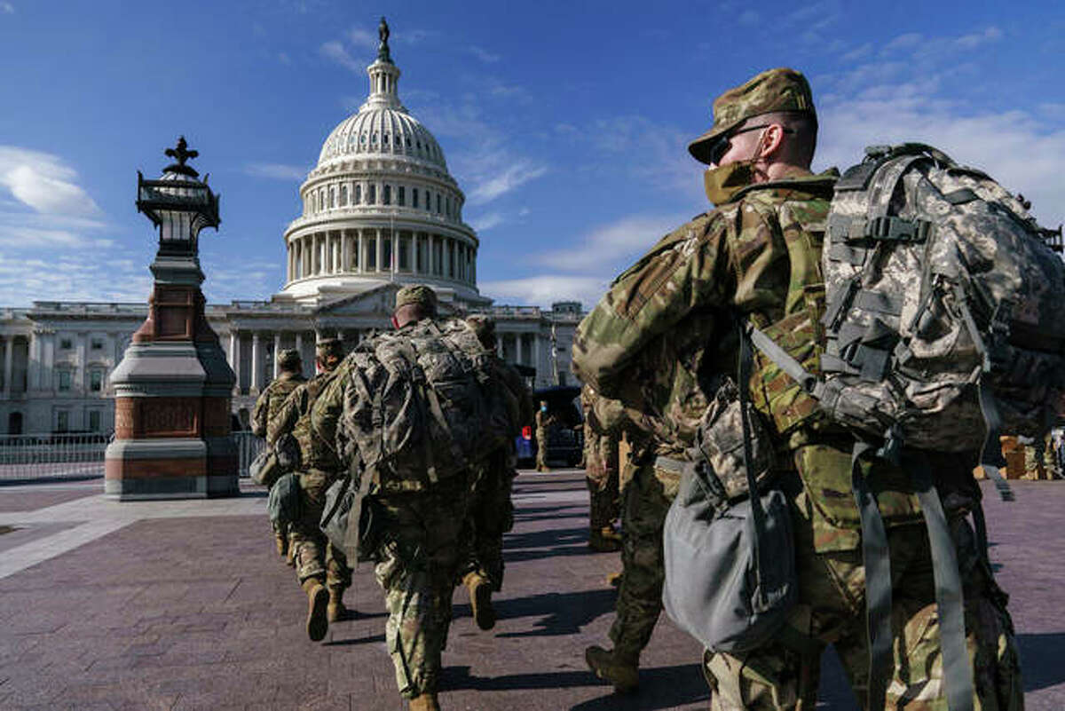 National Guard troops reinforce security around the U.S. Capitol earlier this month following a deadly attack on Congress by a mob of supporters of President Donald Trump.