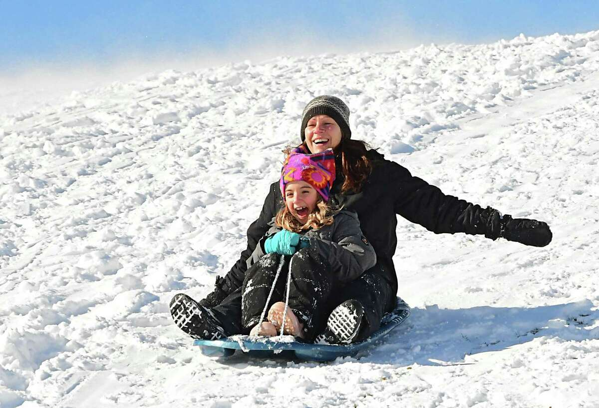 Vanessa Dale of Averill Park and her daughter Annabella, 8, enjoy a sunny but cold day sledding at Capital Hills at Albany Golf Course on Thursday, Jan. 28, 2021 in Albany, N.Y. (Lori Van Buren/Times Union)
