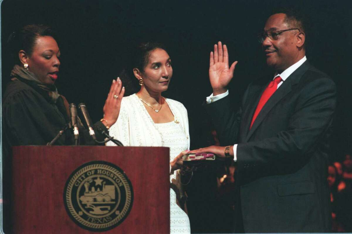 U.S. District Judge Vanessa D. Gilmore administers the oath of office to Mayor Lee Brown as his wife, Frances, holds the Bible, on Jan. 4, 2000.