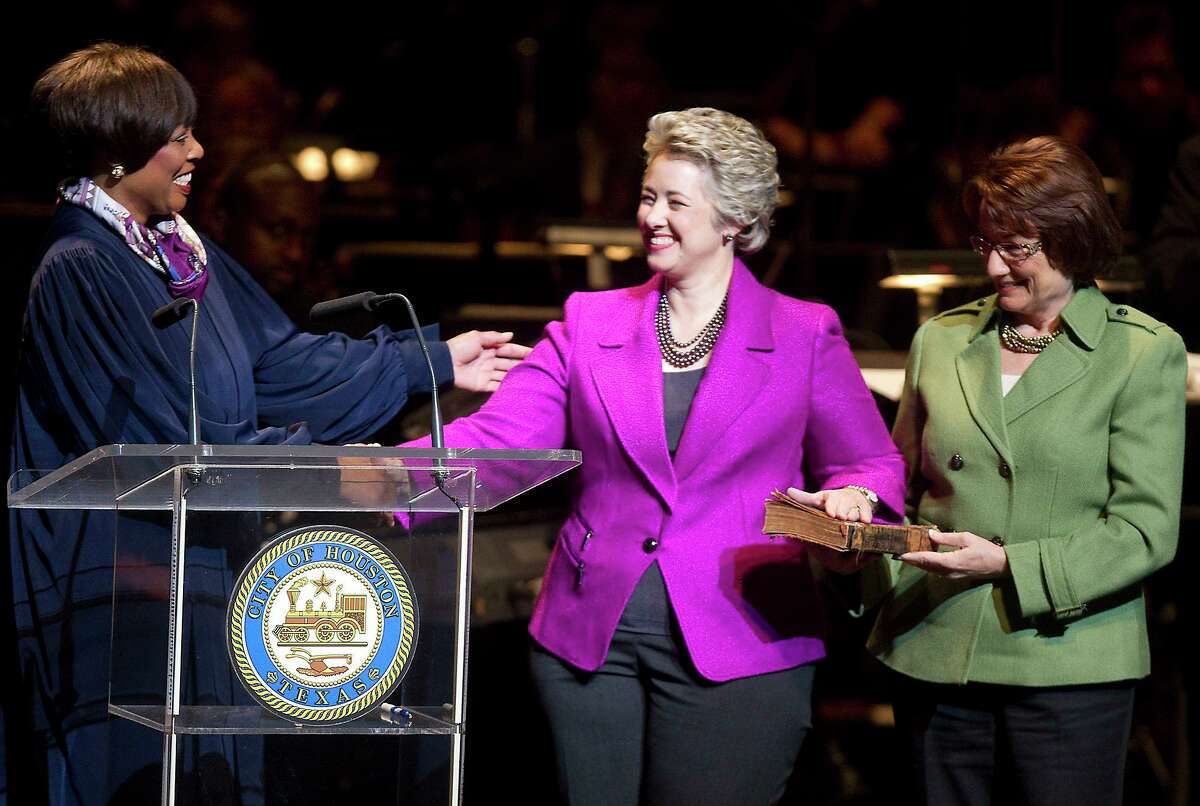 U.S. District Judge Vanessa Gilmore administers the oath of office to Houston Mayor Annise Parker, with her life partner Kathy Hubbard by her side.