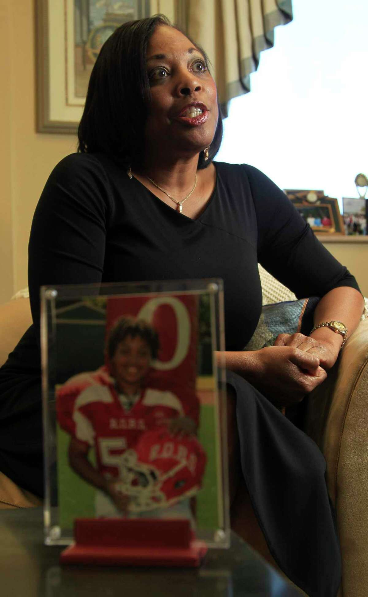 Federal Judge Vanessa Gilmore in her office with a photograph of her son, Sean, 13, Monday, Jan. 13, 2014, in Houston.