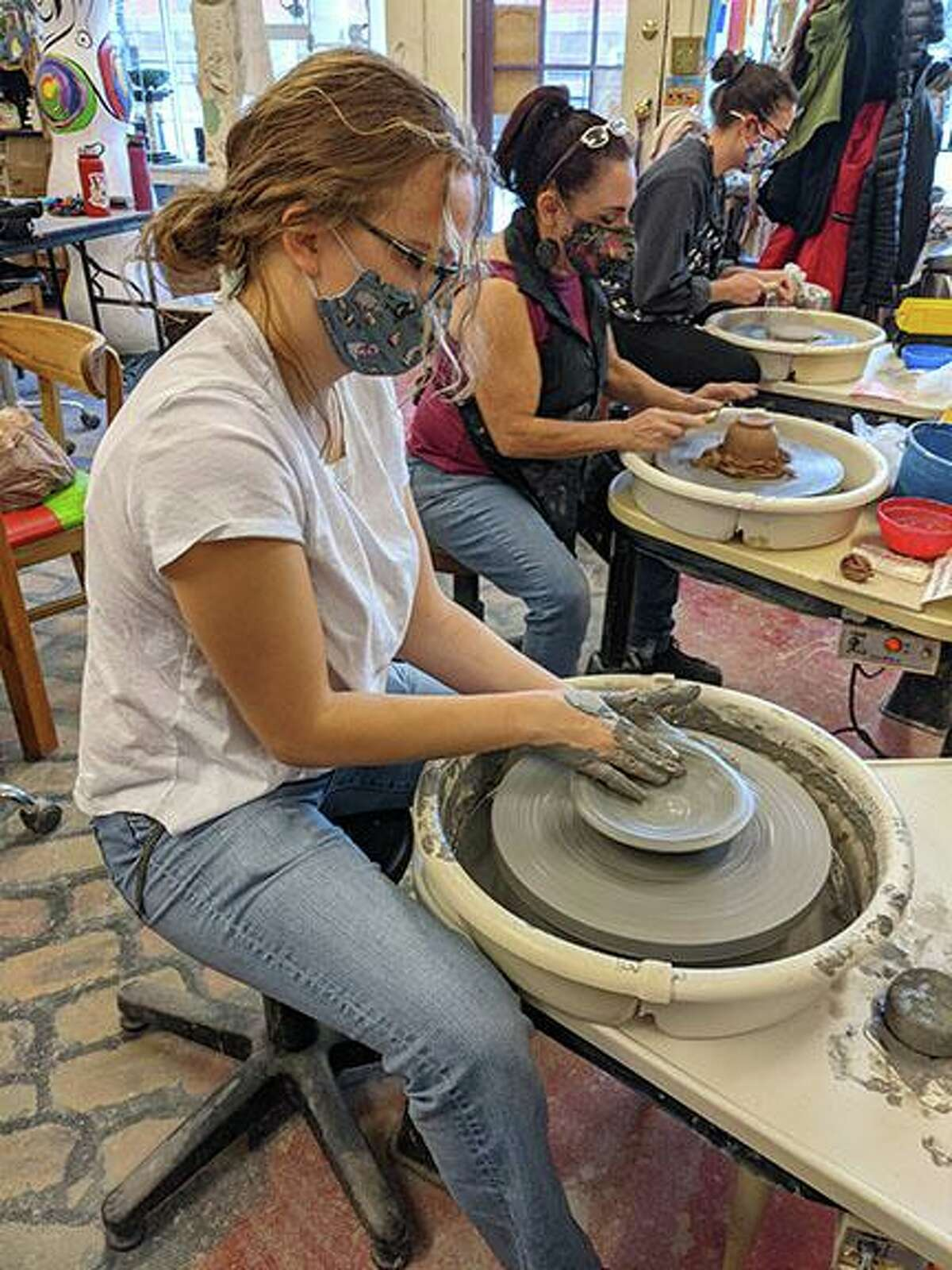 At pottery wheel in a Village Center for the Arts studio.