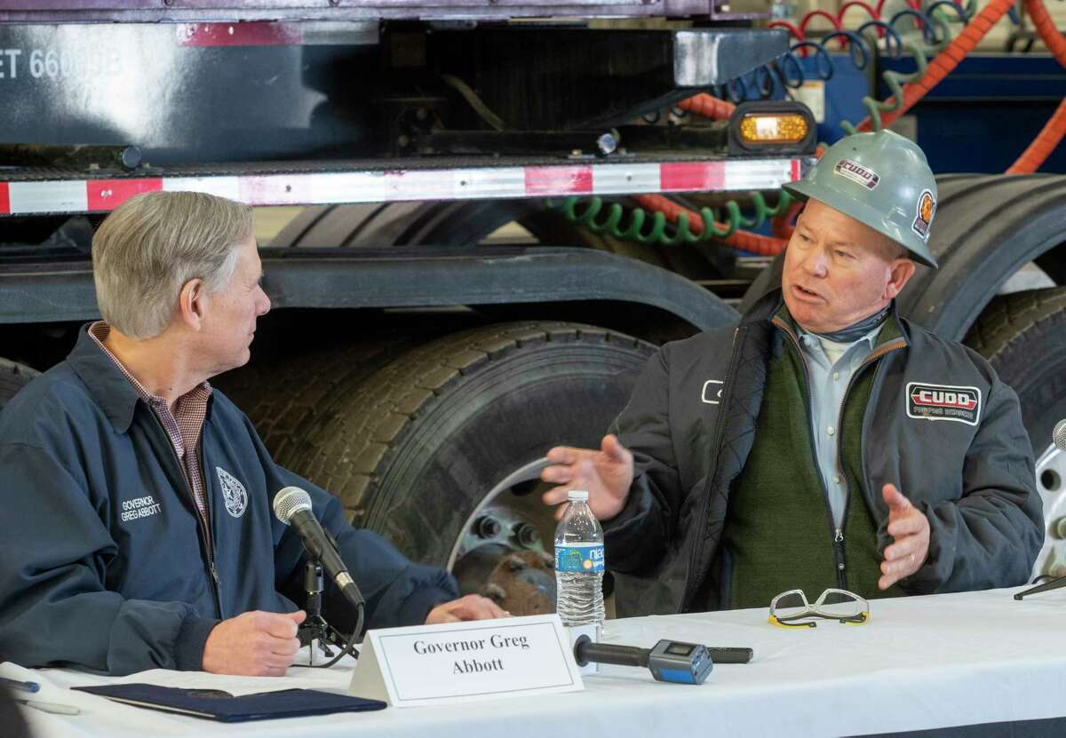 Texas Governor Greg Abbott talks with Clint Walker, with Cudd Energy Services 01/28/2021 at Cudd Energy Services in Odessa, during a roundtable discussion about the industry. Tim Fischer/Reporter-Telegram