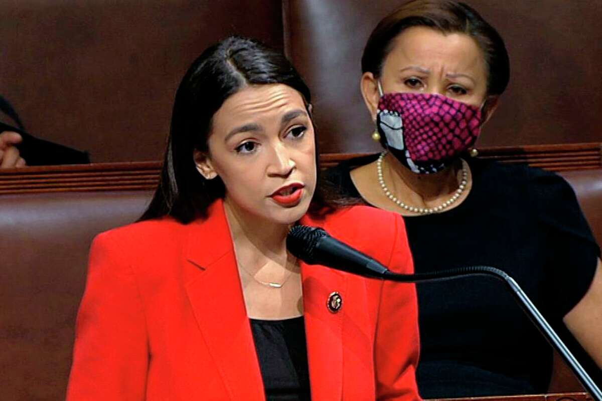 In this July 23, 2020, file image from video, Rep. Alexandria Ocasio-Cortez, D-N.Y., speaks on the House floor on Capitol Hill in Washington. Rep. Ocasio-Cortez called on Sen. Ted Cruz to resign in a tweet. (House Television via AP, File)