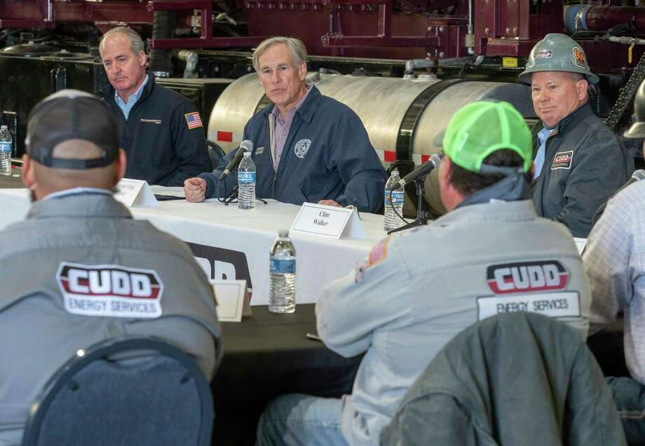 Texas Governor Greg Abbott leads a roundtable discussion with Travis Stice, left, with Diamondback Energy and Clint Walker, right, with Cudd Energy, 01/28/2021 at Cudd Energy Services in Odessa, with oil and gas leaders and workers, as well as state legislators. Tim Fischer/Reporter-Telegram Photo: Tim Fischer, Midland Reporter-Telegram