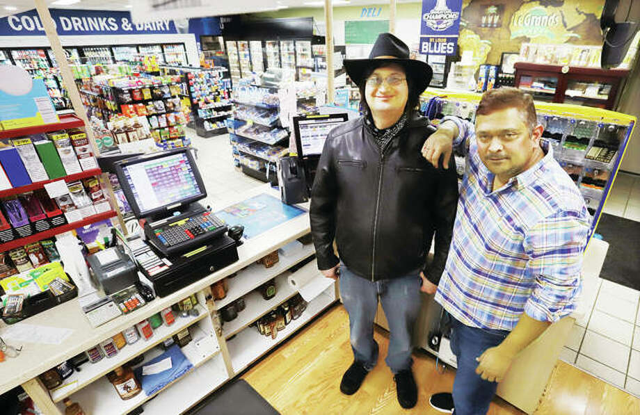 The Godfrey BP Station at 1918 W. Delmar Ave. has sold a lottery ticket worth $2 million to a group of 18 unidentified winners. Station owner Sammy Desai, right, stands with the employee who sold the ticket, Mitchell Landon.
