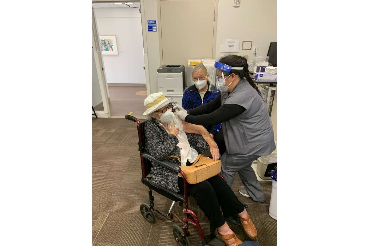 105-year-old Ursula Haeussler receives her first dose of the COVID-19 vaccine at Kaiser Permanente Fremont's vaccination clinic.