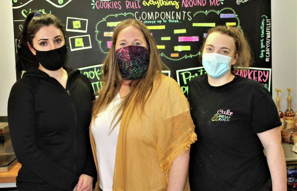 The Cake, Batter and Roll bakery opened in December at 124 College St., Middletown. Shown, from left, are employee Selda Radoncic, owner Lindsey Chartrand, and baker Kristin Tyler.